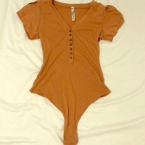 Rust colored button down bodysuit